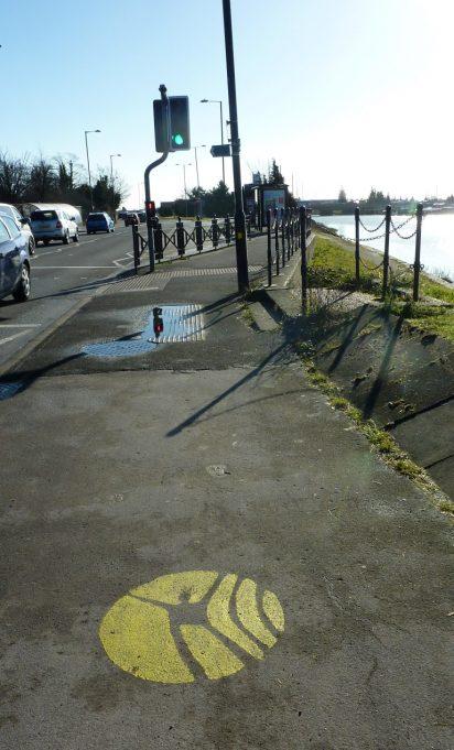 Thames Estuary Path yellow marker outside Benfleet rail Station.   Margaret March