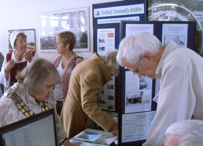 CPDC Mayor Mrs Jackie Govier visiting the stall and talking to Phil Coley. In the background is member Margaret March talking with the Mayor's escort, who was in period dress. | Christine Coley