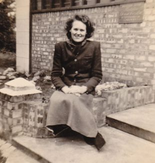Peggy Eason sitting on the front steps of  Turtella Dressmakers | Denise Neale