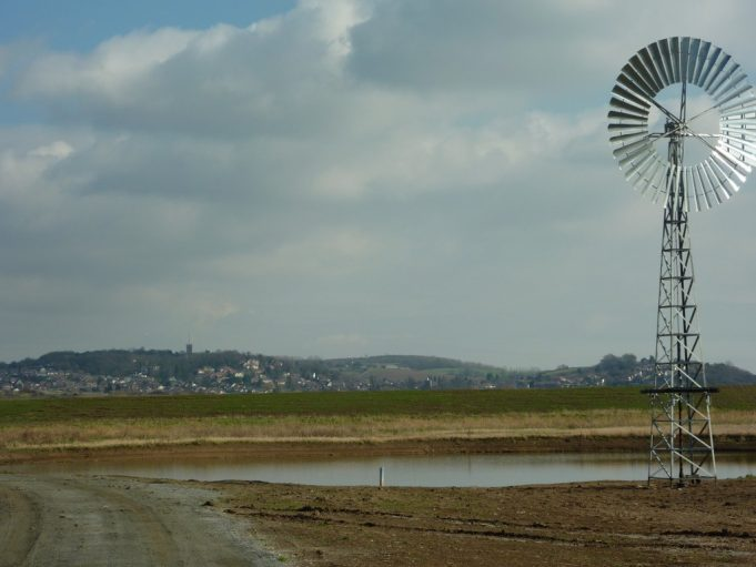 One of the wind pumps, Benfleet and The Downs in the background.  Benfleet looks rather impressive from the marsh as the tree covered Vicarage Hill and Downs rise above the flat land.   Spring 2012. | Margaret March