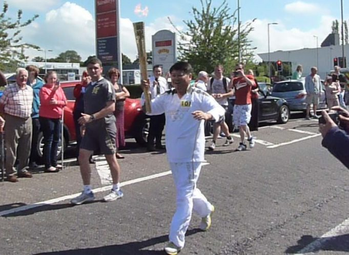 Torchbearer 101, Shaowen Huang from Beijing, carrying the Olympic Torch to the Lantern | Jenny Day