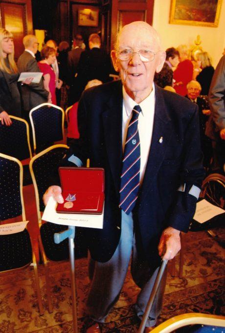 Mr Joyce after receiving his medal | Mr Joyce's son