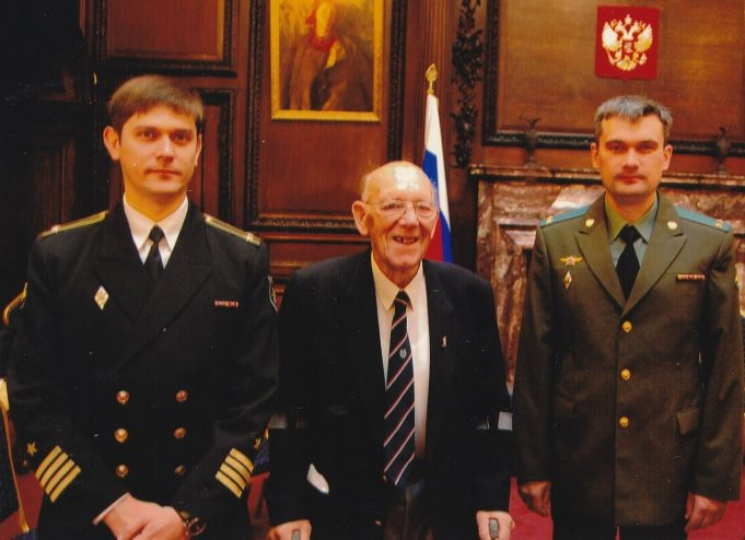 Mr Joyce posing with serving officers of the Russian forces | Mr Joyce's son