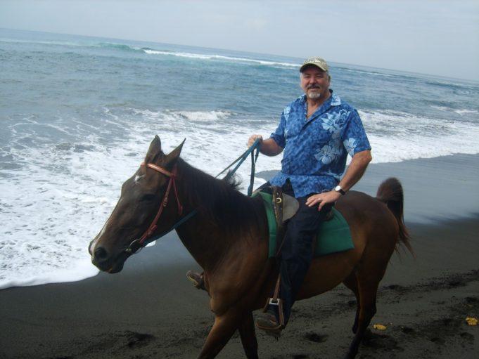 Doug on horseback in Bali | Doug Mansfield