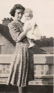 Mum holding Janice - standing on the flat roof | Janice Jiggens