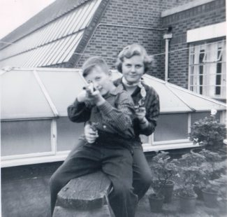 Janice and John playing on the flat roof | Janice Jiggens