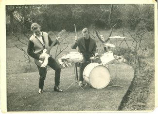 Alan on guitar, Fred on drums. The clothes are typical of the early 1960s, including winkle picker shoes. | Harry Emery