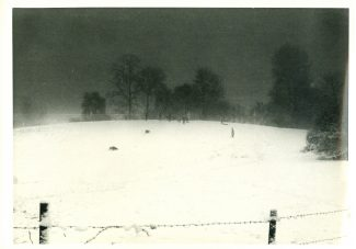 Sledging on the Green Hill at dusk early 1960s, with no brakes on the sledge you would often career into the barbed wire | Harry Emery