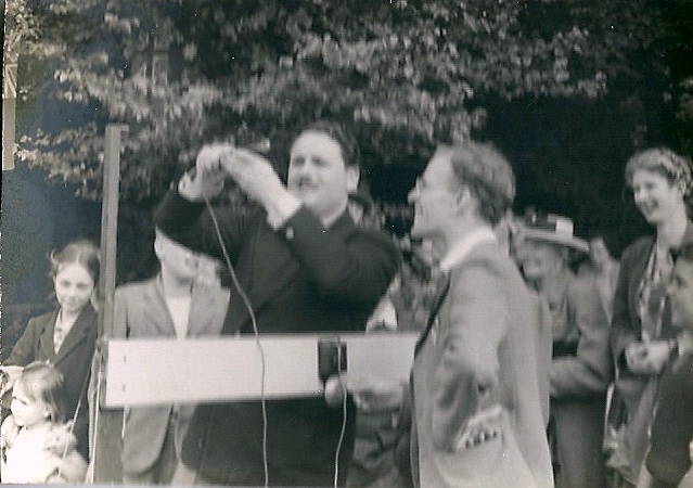 Sir Bernard Braine MP tries his luck at the church fete, date unknown. | Gilbert Wines