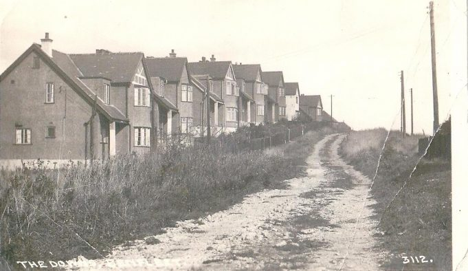 St Mary's Road in the 1930's looking out over Benfleet Creek.  These houses are at the end of St Mary's Road just before the entrance to the Country Park.  In the 1930's one of these houses was called 'Jesmond' and it is thought to now be number 65. | Rene Jones who lived at 'Jesmond' in the 1930's and 1940's