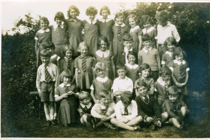 Group photo - Audrey Martin is in the centre of the middle row, she is wearing a dress with a large white collar. The young man far right in the back row is possibly Christopher Gardner, son of the Reverend Ralph Gardner. | Julie Summers