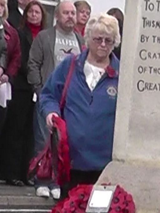 The Lions Club of Castlepoint's representative lays a wreath | Christine Coley