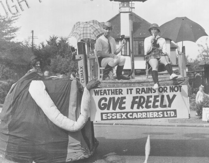 A Coventry Climax fork lift mounted float with Eddy Barber driving and Michael Brittain (centre) a passenger, along Marine Parade, Leigh on Sea   RBB