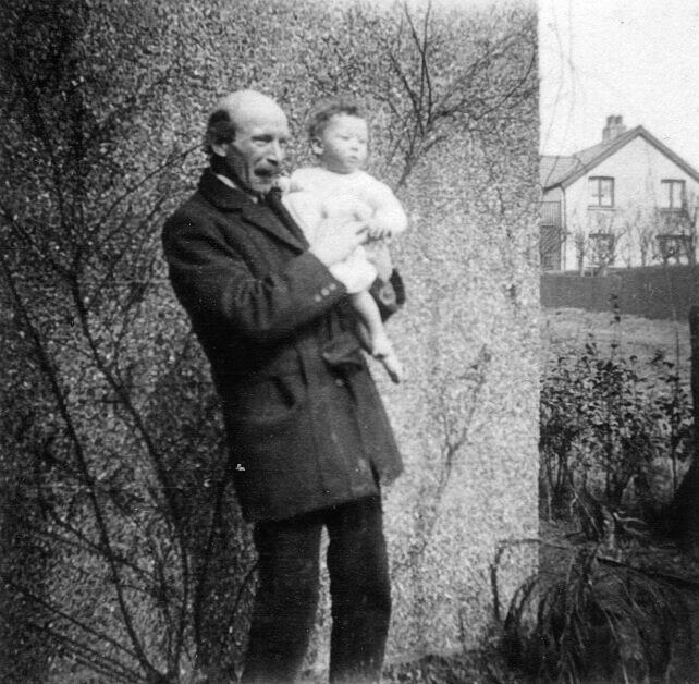 Sidney (Sydney) Fairs Williams holding his son Gwynne.   Anne Harley