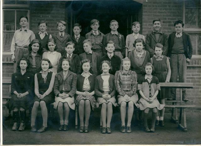 Benfleet School Pupils around 1947.  From left to right centre rear row Sam McKay, Middle row 2nd from left June La Roche, ? Gates, ?, John Baker,  Front row Iris Nicholls, Janet Layell, 5th from left Sheila Frith, 6th Jean Howard. | From the collection of Miss Bass, now Mrs Williams