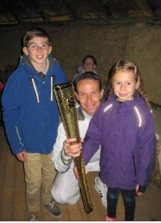 Proudest Moment - holding the Olympic torch accompanied by my two children, Joshua aged 11 and Emily aged 6. | Alex Richardson
