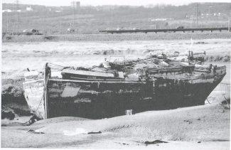 Abandoned spritsail barge