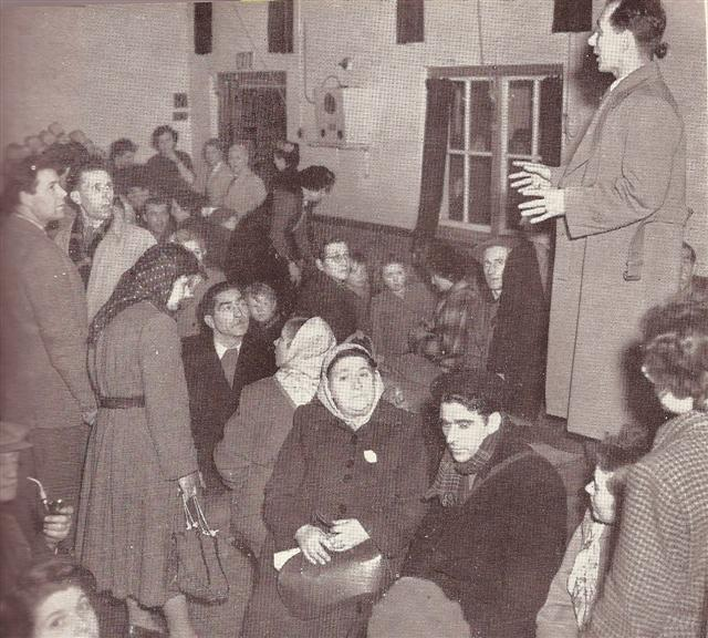 'An official at the refugee centre in Benfleet school giving directions to the refugees from Canvey Island.'