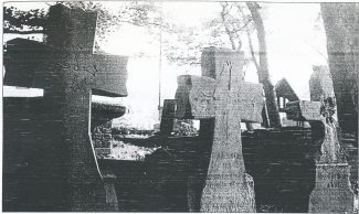 John Cook's grave (centre) with his sister, left and mother, right
