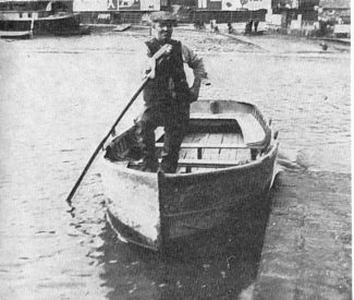 This photo shows one of the last of the ferrymen operating his small boat across the waters of Benfleet Creek. c.1920s
