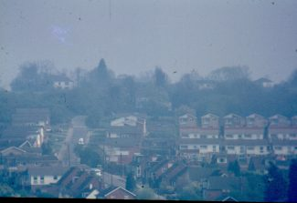 Photo taken late 1970s from the footpath on Boyce Hill Golf Course, looking up Hill Road.  The white house top left  is 'Jarvis Hall'.   Harry Emery