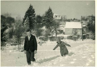 My brother Alan and me, probably taken in the late 50s, in the field opposite 'Lyndhurst'.  Bob and Nell Wood's bungalow is in the background. | Harry Emery