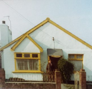 Front view of the whitewashed 'Manor Cottage' in 1974   Pamela-Jeanetta Bird Gaines