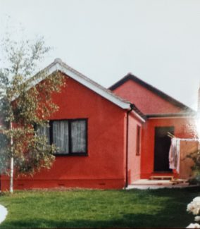 Back view of 'Manor Cottage' painted Cinnabar after the extension was added in 1985 | Pamela-Jeanetta Bird Gaines