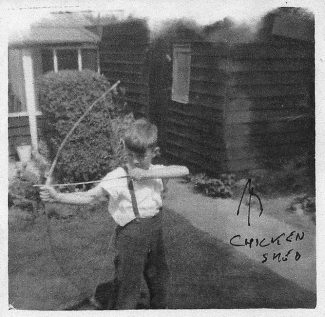 Playing in the garden with my bow and arrows in 1954   John Garnham