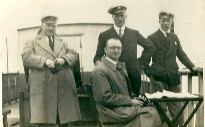 Race officials aboard the 'Soar' in Benfleet Creek. Bill Ward is standing in the center of the picture.  Does anyone know who the other men are? | Gilbert Wines