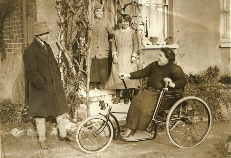 Local Councillor Mr Bingham gives May Thurtell a new wheelchair.