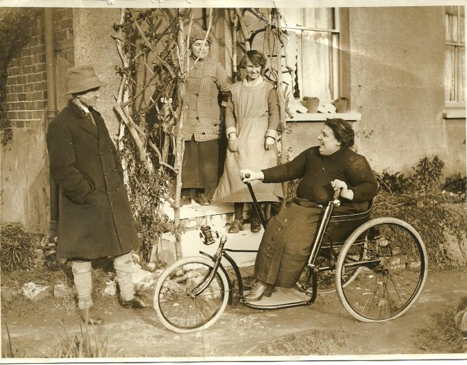 Local Councillor Mr Bingham gives May Thurtell a new wheelchair. (in the background is Mrs Allen & Elizabeth Pratt). Taken at End Way ( now Essex Way)