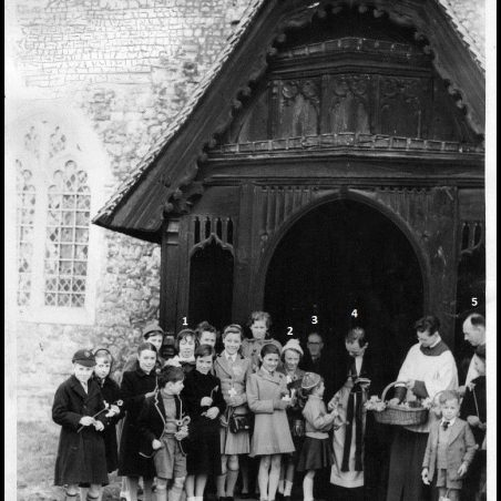 Photo 1: A gathering of people outside the porch of St Mary's Church. 1. Vera Clark (Partridge).  2. Gillian Watts. 3. Mr Ernest Quilter. 4. Reverend L Rooney.  5. Mr Percy Cox.   c.1960 | Jackson's Photo Service
