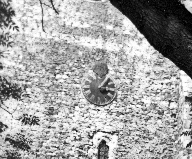 Close up of the church clock showing the bees nest at 12 o'clock   Betty Matson