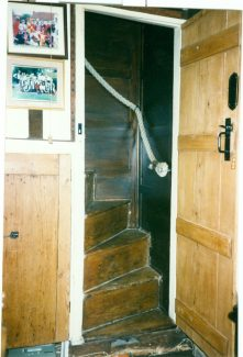 Stairwell, with traditionally reefed rope bannister rail.