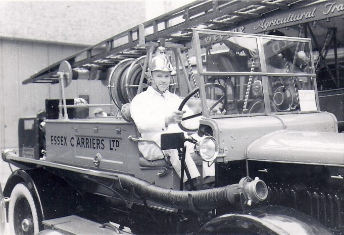 One of Essex Carriers fleet was their very own fire engine and in this photograph we see Mr. Richard Brittain, Managing Director of the company sitting proudly on the machine. | F. Lazell