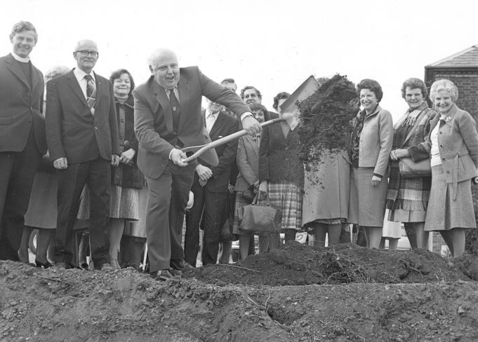 Dr Doug Acres throwing the first soil during the construction of Abbeyfield House, Chapel Lane, Hadleigh.  April 1982 | © Echo Newspapers