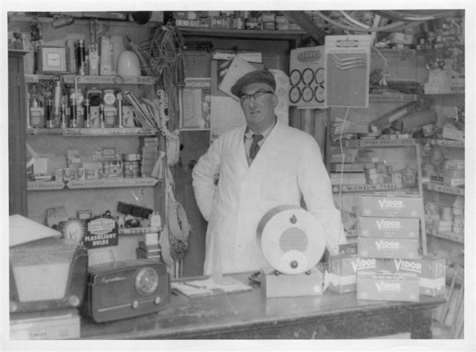 George Foster at the counter of his shop in the High Road.  (date unknown) | Ralph & Joan Pickett