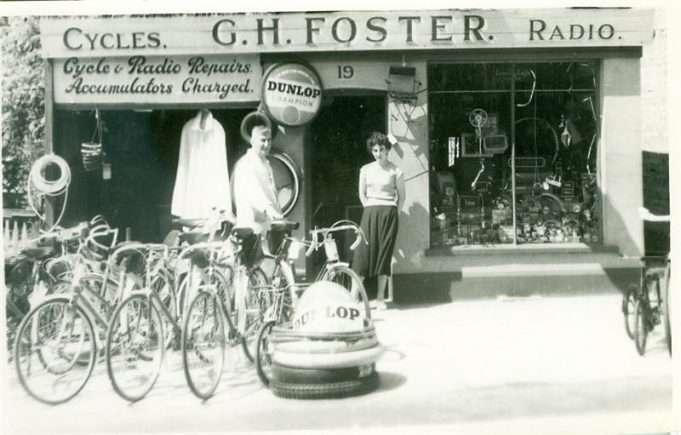 Joan Foster with her father George, standing outside the shop. (circa 1950) | Ralph & Joan Pickett