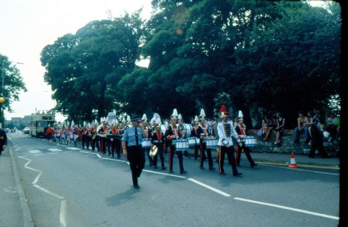 A marching band - but which? They are carrying a Texas banner, perhaps sponsors? | Ronnie Pigram