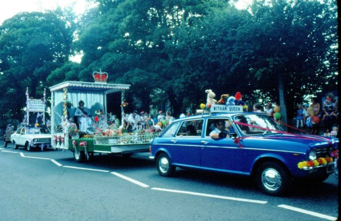 The blue vehicle/float the Witham Queen and Court. The float behind states Burnham Band and Majorettes. | Ronnie Pigram
