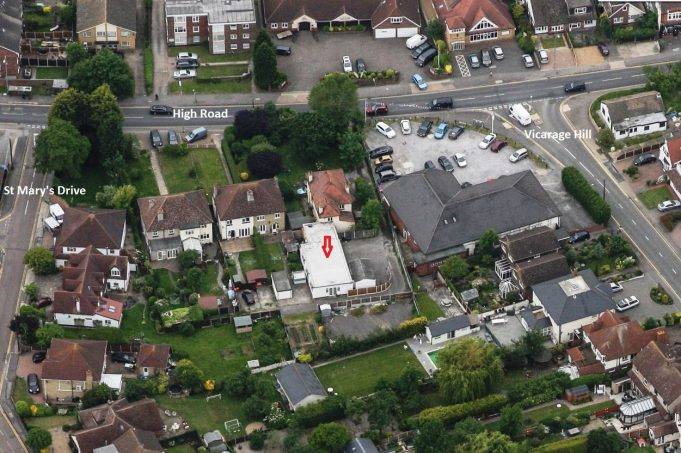 Aerial view taken in recent years showing the extension which was the school Hall (see red arrow) the shape being easily identifiable with Postcard 3, above.  c. mid 1930s