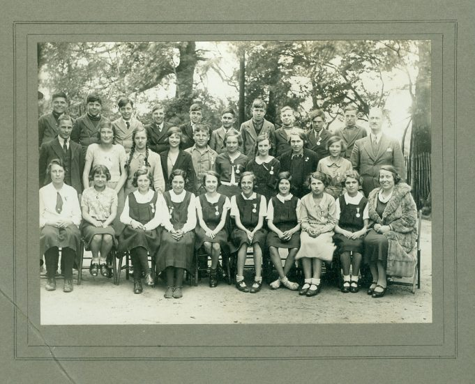 Class photo - date unknown. Colonel Bransden stands at the back, far right but who is the lady seated at the front wearing a fur coat? | Thundersley Primary School