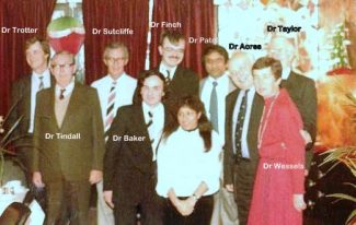 Helen, surrounded by her colleagues at Rushbottom Lane Surgery   Norman Sutcliffe