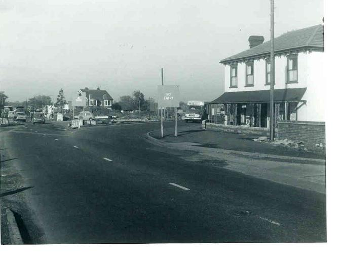 Work has now started and in the background the roundabout is taking shape. The imposing double fronted house centre/left of the picture still stands today.The colonial style property, far right, was demolished in later years and today a bus station stands on the site
