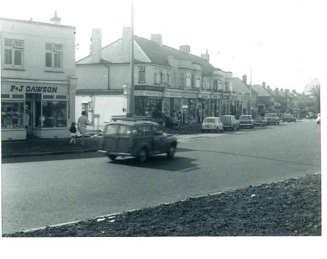 Work in progress.  Note the shop on the left has changed hands and the small one storey shop has been demolished.