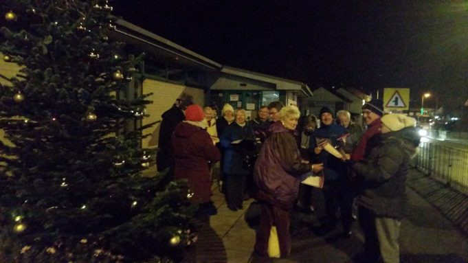 Benfleet Operatic Society singing around the Christmas Tree,  Benfleet High Road Dec. 2017 | Dave Cowan