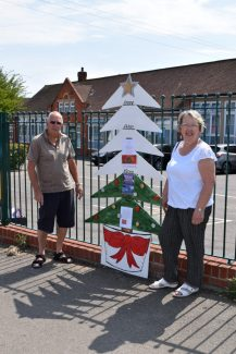 Organizers Janice Gray and Dave Cowan with the Christmas lights fundraising tree indicator outside Benfleet School.  June 2018