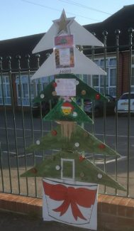 Sad Santa added to repair tree after damage was caused to the tree by unknown persons overnight.  Even a poem was added to the tree by the poet of our group, Phil. | Margaret March