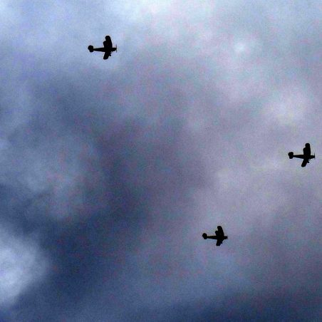 Bi-planes from Stow Maries Great War Aerodrome returning after having made a Poppy Drop,   Jenny Day